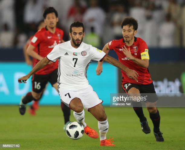 Ali Mabkhout of AlJazira and Yuki Abe of Urawa Red Diamonds during the FIFA Club World Cup match between Al Jazira and Urawa Red Diamonds at Zayed...