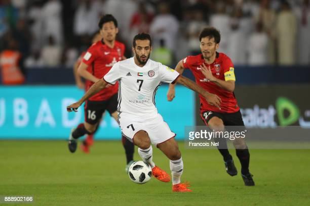 Ali Mabkhout of AlJazira and Yuki Abe of Urawa Red Diamonds during the FIFA Club World Cup match between Al Jazira and Urawa Red Diamonds at Zayed...