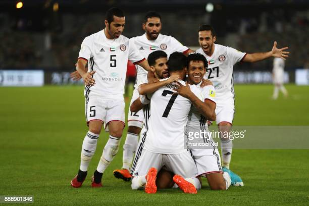 Ali Mabkhout of AlJazira celebrates scoring the first goal with team mates during the FIFA Club World Cup match between Al Jazira and Urawa Red...