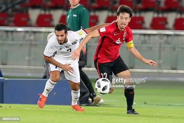 Ali Mabkhout of AlJazira in action against Yuki Abe of Urawa Red Diamonds during 2017 FIFA Club World Cup match between Urawa Red Diamonds and...