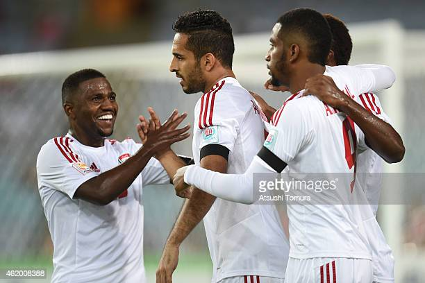 Ali Mabkhout of the United Arab Emirates celebrates with team mates after scoring a goal during the 2015 Asian Cup Quarter Final match between Japan...