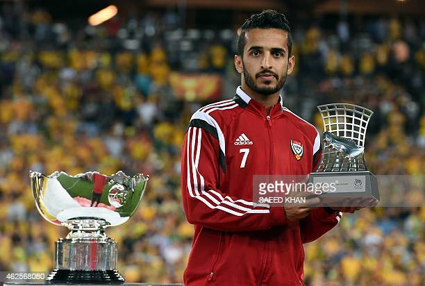 Ali Mabkhout of United Arab Emirates poses for pictures with his trophy during the prize distribution ceremony of the AFC Asian Cup football final in...