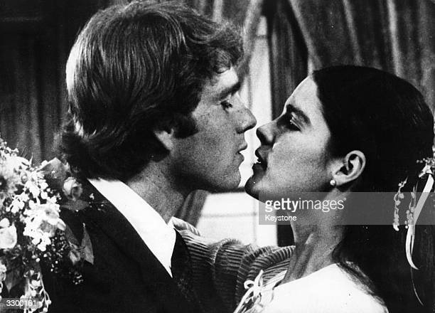 Ali MacGraw and Ryan O'Neal in a loving embrace in a scene from the film 'Love Story' which was voted 'Film of the Year' in 1971 having outrun even...