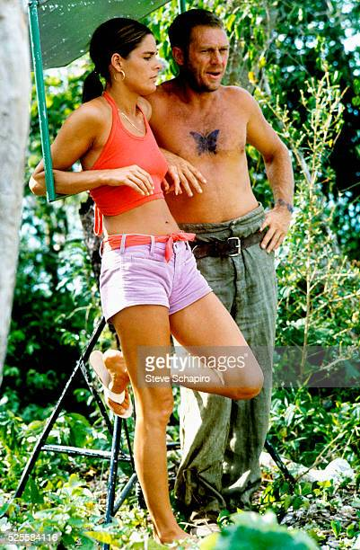 Ali MacGraw and Steve McQueen during a break while filming Papillon a film he stars in with Dustin Hoffman on location in Jamaica