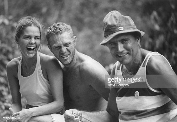 Ali MacGraw Steve McQueen and an unidentified man share a laugh during a break in filming Papillon