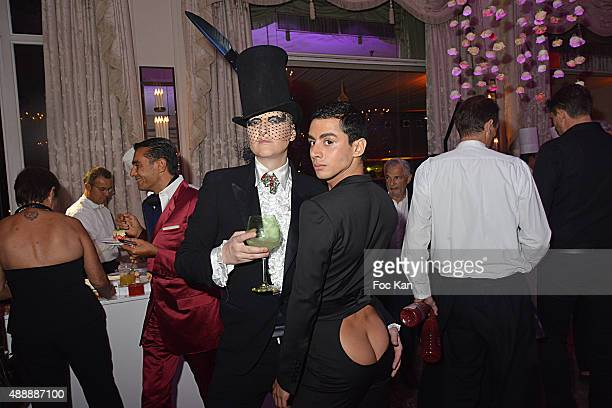 Ali Mahdavi and Djanis Bouzyani attend the Kenzo Takada Celebrates 50 Years of Life in Paris at Le Pre Catalan on September 16 2015 in Boulogne...