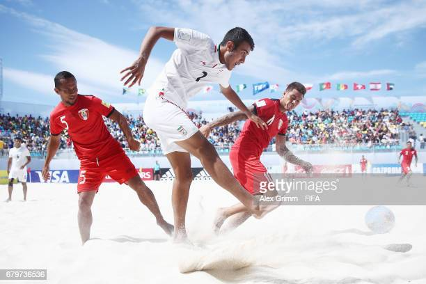 Ali Mirshekari of Iran is challenged by Raimoana Bennett and Tearii Labaste of Tahiti during the FIFA Beach Soccer World Cup Bahamas 2017 semi final...