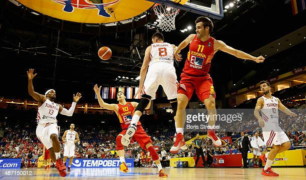 Ali Muhammed of Turkey tries to grab a rebound during the FIBA EuroBasket 2015 Group B basketball match between Turkey and Spain at Arena of...