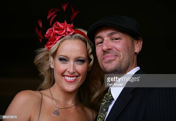 Ali Mutch and Paul Stanner arrive for the Emirates Doncaster Day at the Randwick Racecourse on April 18 2009 in Sydney Australia