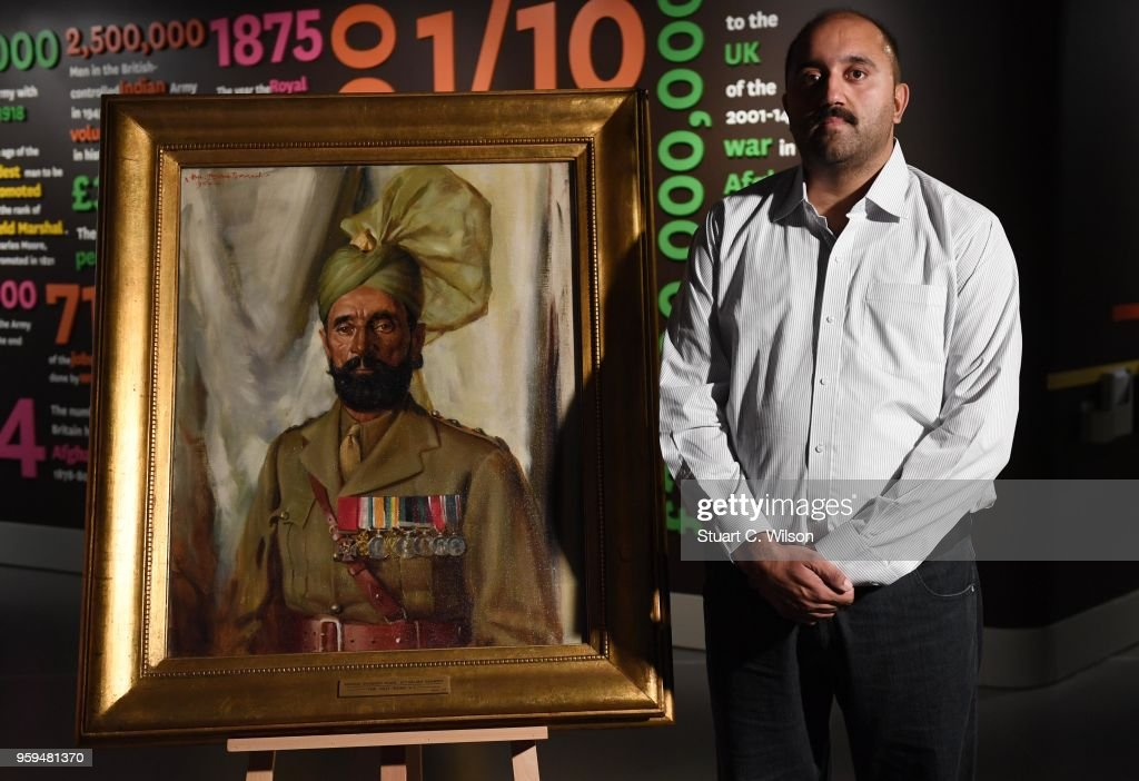 Ali Nawaz Chaudhary stands next to an official portrait of his Grandfather, Khudadad Khan VC, the First Indian Recipient of the Victoria Cross at The National Army Museum on May 17, 2018 in London, England. Ali Nawaz Chaudhary travelled from Pakistan to attend a commemmoration service and view the portrait.