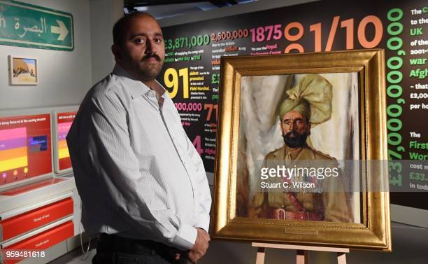 Ali Nawaz Chaudhary stands next to an official portrait of his Grandfather Khudadad Khan VC the First Indian Recipient of the Victoria Cross at The...