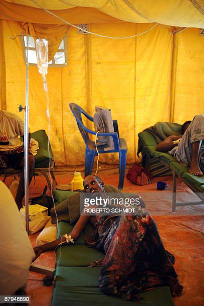 Ali Omar a Somali government soldier who was recently wounded while fighting Al Shebab militias in Somalia's capital lies on a mat on the floor of a...