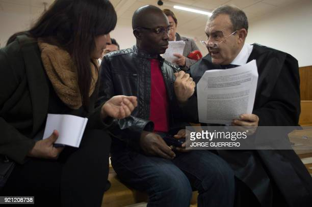 Ali Ouattara 45 talk with his lawyer Juan Isidro Fernandez in court during his trial in Ceuta a Spanish overseas territory in northern Morocco on...