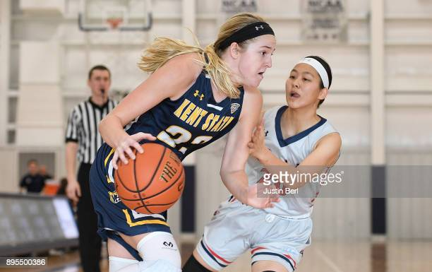 Ali Poole of the Kent State Golden Flashes drives to the basket against Honoka Ikematsu of the Robert Morris Colonials in the second half during the...
