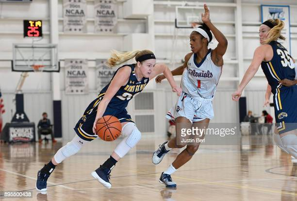 Ali Poole of the Kent State Golden Flashes drives to the basket against Jocelynne Jones of the Robert Morris Colonials in the second half during the...