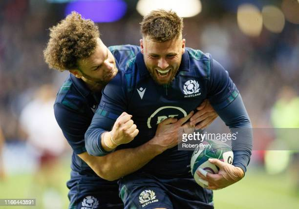 Ali Price of Scotland celebrates with teammate Duncan Taylor of Scotland after Price scored a try during the international match between Scotland and...