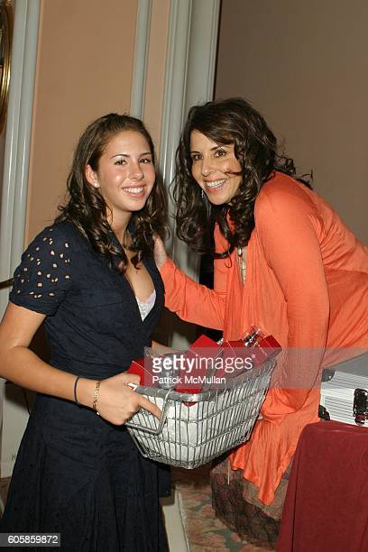 Ali Rambis and Linda Rambis attend Yves Saint Laurent hosts Sport Spectacular The CedarsSinai Medical Center's Annual Women's Luncheon at Crystal...