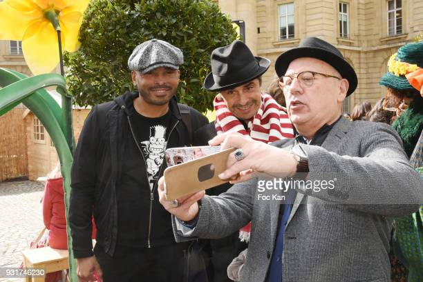Ali Rebeihi Ariel Wizman and a guest pose for a selfie during Une Jonquille pour Institut Marie Curie Place du Pantheon on March 13 2018 in Paris...
