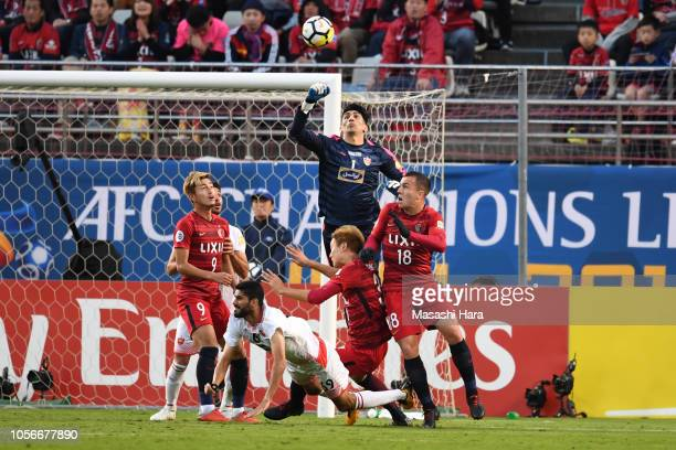 Ali Reza Safarbeiranvand of Persepolis in action during the AFC Champions League final first leg match between Kashima Antlers and Persepolis at...