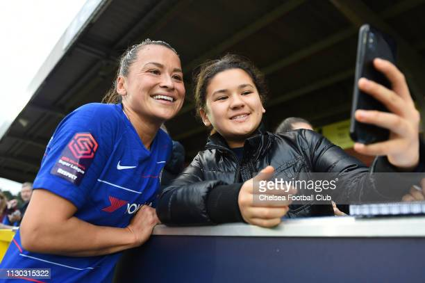 Ali Riley of Chelsea poses for a selfie with fans after the SSE Women's FA Cup Fifth Round match between Chelsea Women and Arsenal Women at The...