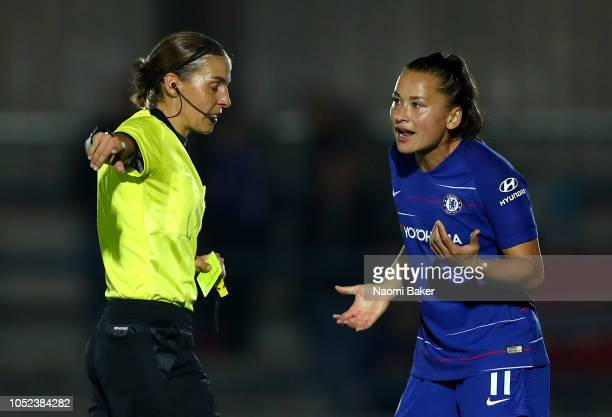 Ali Riley of Chelsea Women argues with referee Stephanie Frappart during the UEFA Women's Champions League Round of 16 1st Leg match between Chelsea...