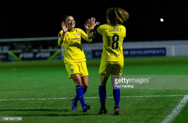Ali Riley of Chelsea Women celebrates with Karen Carney after scoring their second goal on December 12 2018 in Cheshunt England