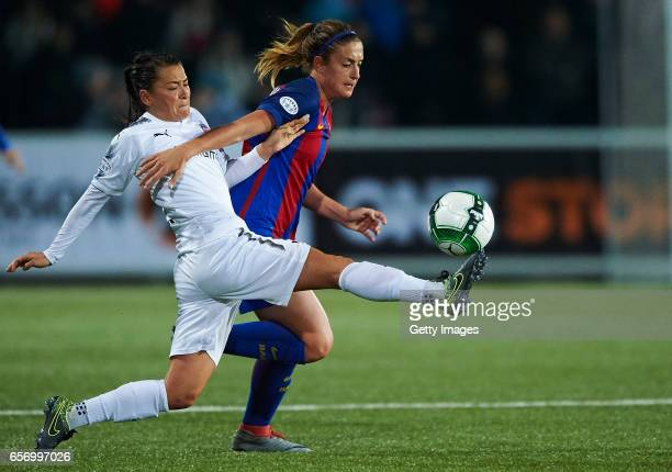 Ali Riley of FC Rosengard and Alexia Putellas of FC Barcelona compete for the ball during the UEFA Women's Champions League match between Rosengard...