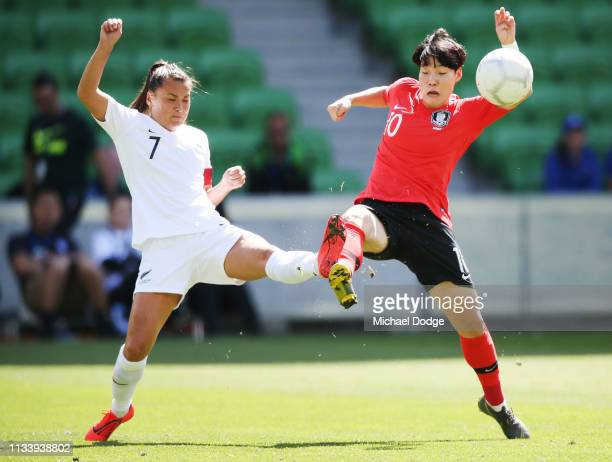 Ali Riley of New Zealand and Lee Geummin of Korea Republic compete for the ball during the Cup of Nations match between the Korea Republic and New...