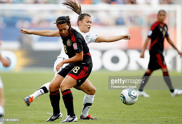 Ali Riley of New Zealand and Veronica Perez of Mexico battle for the ball during the FIFA Women's World Cup 2011 Group B match between New Zealand...