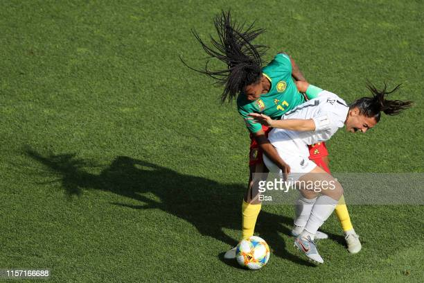 Ali Riley of New Zealand battles for possession with Aurelle Awona of Cameroon during the 2019 FIFA Women's World Cup France group E match between...