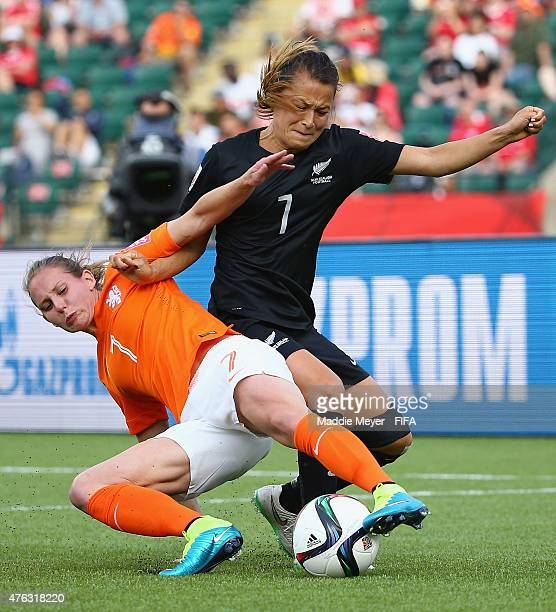 Ali Riley of New Zealand defends Manon Melis of Netherlands during the FIFA Women's World Cup Canada 2015 Group A match between New Zealand and...