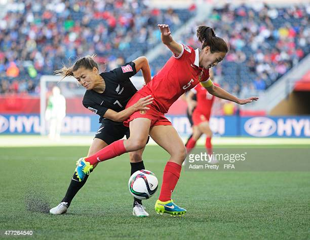 Ali Riley of New Zealand is challenged by Wu Haiyan of China during the FIFA Women's World Cup 2015 Group A match between China PR and New Zealand at...