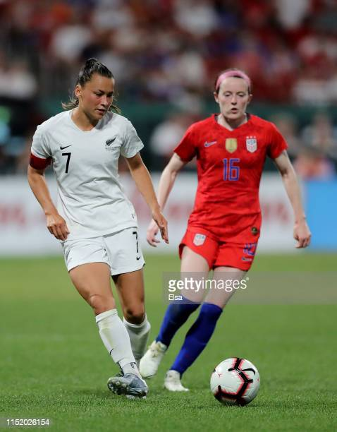Ali Riley of New Zealand passes the ball as Rose Lavelle of the United States defends at Busch Stadium on May 16 2019 in St Louis Missouri