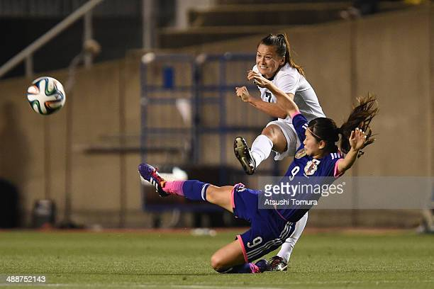 Ali Riley of New Zealand passes the ball while Nahomi Kawasumi of Japan tackles her during the women's international friendly match between Japan and...