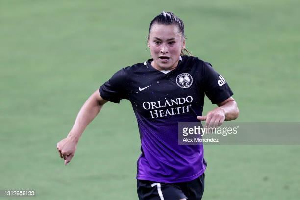 Ali Riley of Orlando Pride plays against Gotham FC at Exploria Stadium on April 14, 2021 in Orlando, Florida.