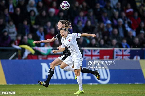 Ali Riley of Rosengard is challenged by Kerstin Garefrekes of Frankfurt during the UEFA Women's Champions League quarter final second leg match...