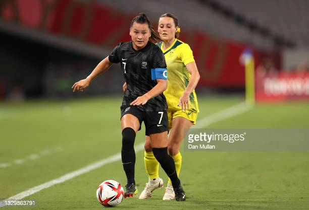 Ali Riley of Team New Zealand runs with the ball whilst under pressure from Hayley Raso of Team Australia during the Women's First Round Group G...