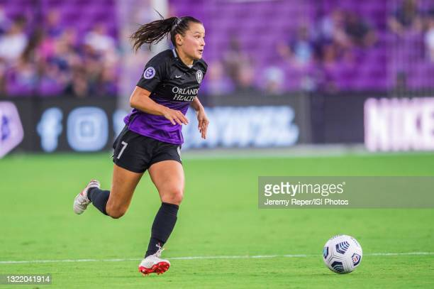 Ali Riley of the Orlando Pride dribbles the ball during a game between Portland Thorns FC and Orlando Pride at Exploria Stadium on May 26, 2021 in...