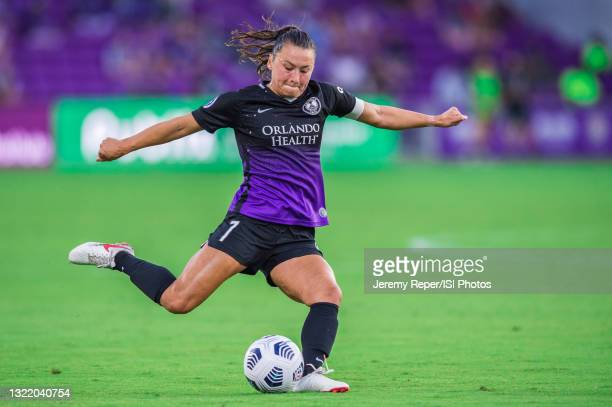 Ali Riley of the Orlando Pride kicks the ball during a game between Portland Thorns FC and Orlando Pride at Exploria Stadium on May 26, 2021 in...