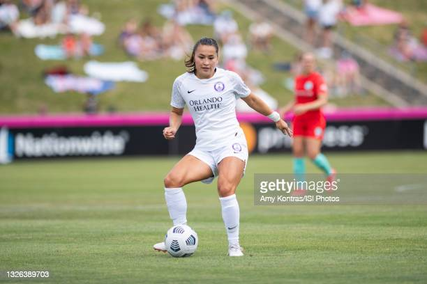 Ali Riley of the Orlando Pride passes the ball during a game between Orlando Pride and Kansas City at Legends Field on June 23, 2021 in Kansas City,...