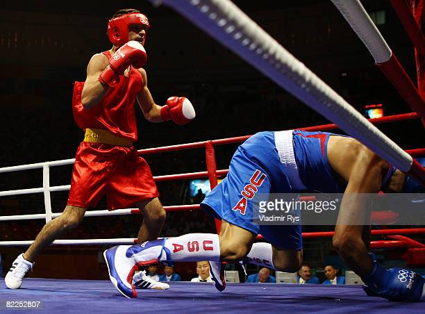 Ali Sadam of the United States is knocked down by Georgian Popescu of Romania during their men's 60kg light weight bout in the boxing event at the...