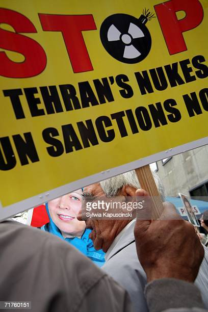 Ali Sephrad of Fairfax Virginia walks in a crowd that demands that the UN Security Council impose sanctions on Iran's regime during a rally near the...