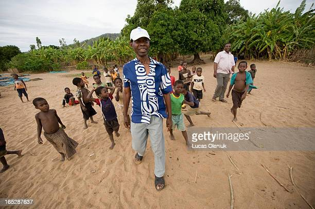 Ali Sikelo is surrounded by children as he walks on the beach of Lake Malawi in Malindi Malawi Sikelo returned to his hometown in 1997 after leaving...