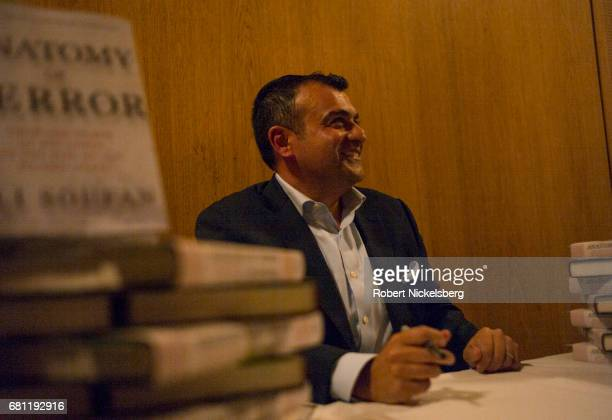 Ali Soufan a former FBIagent who was involved in multiple high profile antiterrorism cases signs copies of his new book Anatomy of Terror May 2 2017...