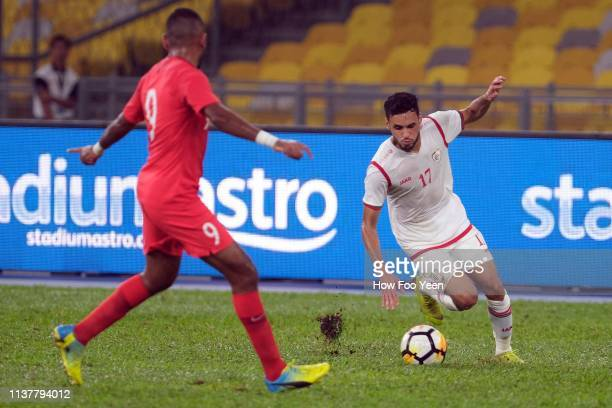 Ali Sulaiman Rashid of Singapore and Mohammed Faritz of Oman in action during the Airmarine Cup final between Singapore and Oman at Bukit Jalil...