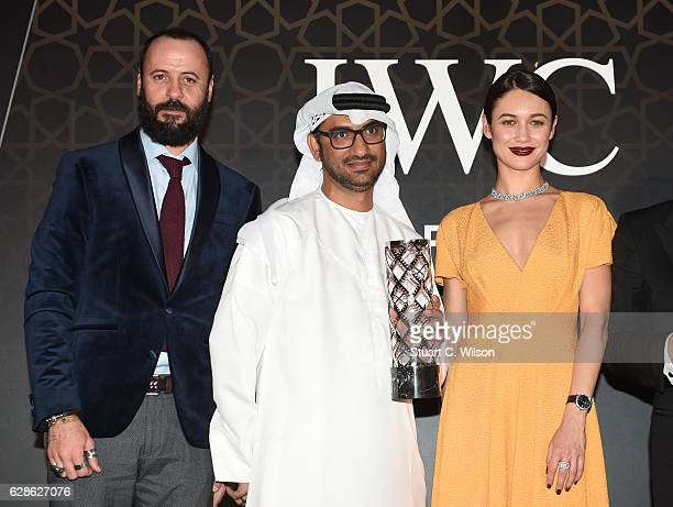 Ali Suliman Actor Abdullah Hassan Ahmed Director Olga Kurylenko Actress and model attends the fifth IWC Filmmaker Award gala dinner at the 13th Dubai...
