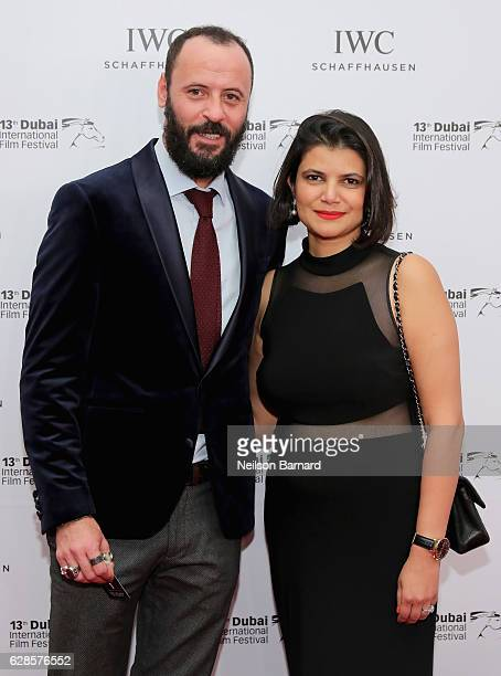 Ali Suliman and Managing Director of DIFF Shivani Pandya attend the IWC Filmmaker Award during day two of the 13th annual Dubai International Film...