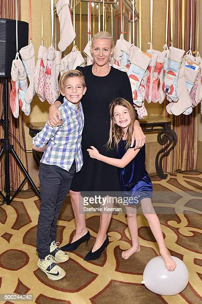 Ali Taekman and children attend the Baby2Baby Holiday Party Presented By Tiny Prints At Montage Beverly Hills on December 6 2015 in Beverly Hills...