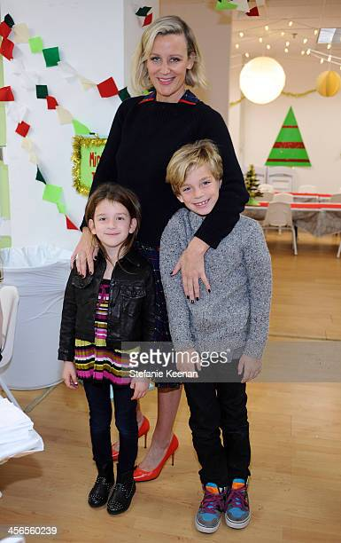 Ali Taekman and Fadie and Finn attend the Third Annual Baby2Baby Holiday Party presented by The Honest Company on December 14 2013 in Los Angeles...
