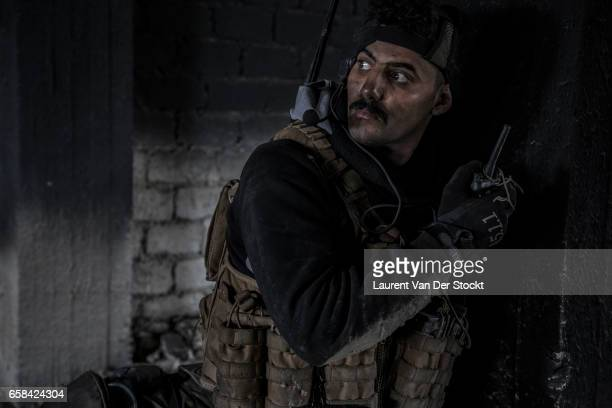 Ali the liaison officer of the Iraqi Federal Police Emergency Response Division who will be wounded at the end of the day during a battle on their...